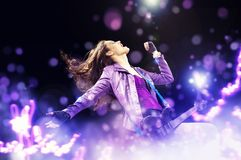 Rock passionate girl with color background Royalty Free Stock Photos