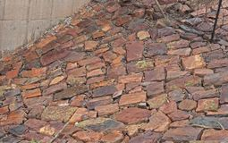 ROCK PAVING ON A SLOPE. Flat red stones used to pave a sloped surface Stock Images