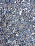 Rock and pebble texture. Photo of flooring made out of rocks and pebbles. Great for adding texture or blending Royalty Free Stock Images