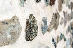 Rock pebbles in a wall. Pebbles embedded in a wall Royalty Free Stock Image