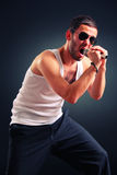 Rock performer. A young rock performer singing Stock Image