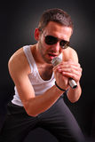 Rock performer. A view of a young rock performer Royalty Free Stock Photography