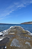 Rock pier in winter on Seneca Lake. Showing the Seneca Lake rock pier after winter storm Stella. One of the Finger Lakes of New York State. At 38 miles long and royalty free stock image
