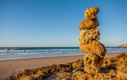 Rock pile on beach royalty free stock images