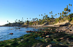 Rock Pile Beach at Low Tide in Laguna Beach, California. Image shows Rock Pile Beach at low tide with Heisler Park above on the bluff.This location is just north royalty free stock photos