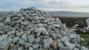 Rock Pile of granite on top of mountain. This is a picture of granite rocks piled up on top of a mountain in Dublin, Ireland. This is the burial site of ancient royalty free stock image