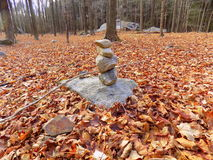 Rock Pile. Left in the middle of the woods around dried leaves Royalty Free Stock Photo