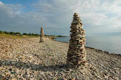 Rock piles by the coast of the Swedish island Oland. Rock piles at a clear blue sky by the coast of the Swedish island Oland royalty free stock images
