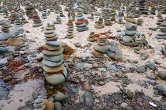 Rock Piles, Great Ocean Road, Victoria, Australia. Many rock piles, cairns or stacks on sandy beach at Carisbrook Creek near Apollo Bay, Great Ocean Road Royalty Free Stock Photography