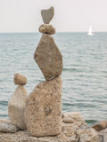 Rock Piles. Inukshuk rock piles by Lake Ontario in Oakville, Ontario, Canada Royalty Free Stock Photos
