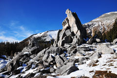 Rock piles and mountains stock photography