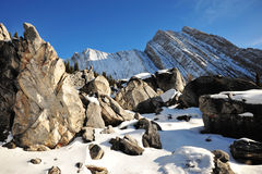 Rock piles and mountains Stock Images