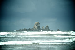 Rock pillar in the ocean Stock Images