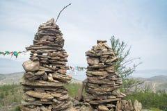 Rock pillars on top of the hillock dedicated to a local Tutelary deity. Siberia, Russia stock photo