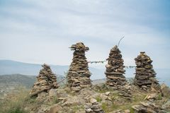 Rock pillars on top of the hillock dedicated to a local Tutelary deity. Siberia, Russia stock images