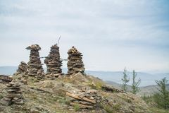 Rock pillars on top of the hillock dedicated to a local Tutelary deity. Siberia, Russia royalty free stock photos