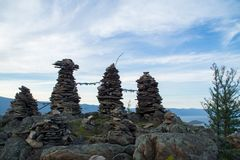 Rock pillars on top of the hillock dedicated to a local Tutelary deity. Siberia, Russia royalty free stock photo