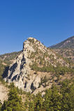 Rock pinnacle and blue sky. A rocky pinnacle rises up against a deep blue cloudless sky near Lytton, BC, Canada Stock Photography