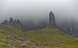 Rock pinnacle The Old Man of Storr in the fog Stock Photos