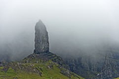 Rock pinnacle The Old Man of Storr in the fog Stock Images