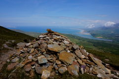 Rock piramid on mountain ireland. Climbing mount brandon in ireland ocean on background Royalty Free Stock Photo