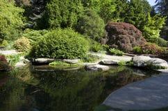 Rock, pond, carp fish in Kubota garden Stock Photos