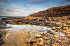 Rock Pool below Ebb`s Nook. Beadnell Point, also known as Ebb`s Nook from an old eighteenth century chapel, is a headland just north of Beadnell harbour Stock Photos