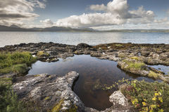 Rock pool at Clach na Criche on the Sound of Mull. Rock pool at Clach na Criche on the Sound of Mull in Ardnamurchan in Scotland Royalty Free Stock Photo