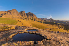 Rock Pool in front of the peaks stock image