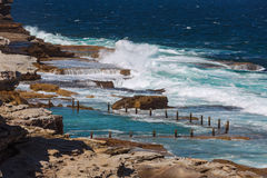 The rock pool at Maroubra beach. Beautiful seascape of the rock pool at Maroubra beach in Sydney, Australia.  long exposure shot Stock Images