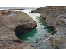 Rock pool by the ocean Stock Photos