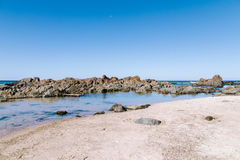 Rock pool. A rock pool at sea in bright light Royalty Free Stock Photos