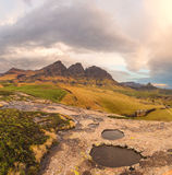 Rock Pools, Peaks and Clouds Stock Image
