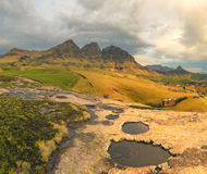 Rock pools and peaks Stock Images