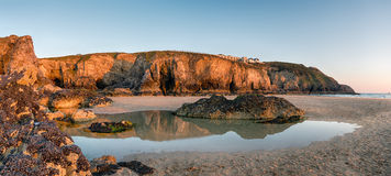 Rock Pools at Perranporth in Cornwall. High cliffs and rock pools at low tide on Perranporth beach on the Cornwall coast Stock Photography