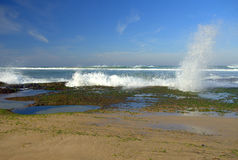Rock pools and seaspray Stock Photos