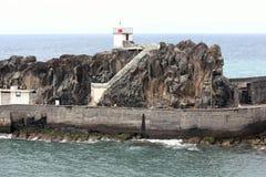 Rock at the port of Camara de Lobos in Madeira Stock Images