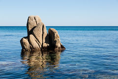 Rock protruding from the sea. Stock Photo