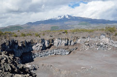 Rock quarry against the volcano Etna Royalty Free Stock Photos