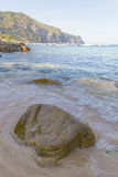 Rock on a quiet calm beach in the Mediterranean coast Royalty Free Stock Photography