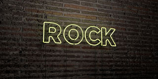 ROCK -Realistic Neon Sign on Brick Wall background - 3D rendered royalty free stock image. Can be used for online banner ads and direct mailers Royalty Free Stock Photography