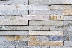 Rock rectangular bricks forming a wall pattern Stock Photography
