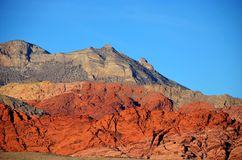 A rock is red in the mountains. Red rock mountain in the Mojave desert Stock Images