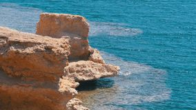 Rock in the Red Sea on the Beach of Egypt. Fine Background for the Resort Vacation. South Sinai. Beach in a Bay on the Coastline with Waves and Coral Reefs stock video footage
