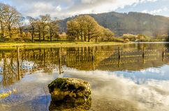 Rock reflected in Derwentwater Royalty Free Stock Photos