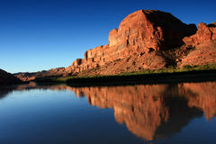 Rock Reflection. Red rock formation and reflection in river at sunrise in desert southwest royalty free stock photos