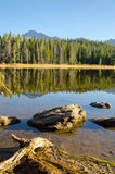 Rock and Reflection in Colorado Lake Stock Photo