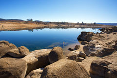 Rock reflections in lake. Jindabyne, Snowy Mountains Australia Royalty Free Stock Photography