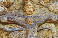 Rock relief - God and Jesus on the cross Royalty Free Stock Photos