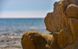 Rock resembling a monkey in front of the sea stock photos